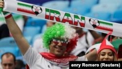 RUSSIA -- Iranian soccer fans cheer prior to the Russia 2018 World Cup Group B football match between Morocco and Iran at the St. Petersburg Stadium in St. Petersburg. June 15, 2018