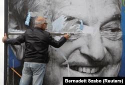 Unul din afișele demonizînd figura lui George Soros
