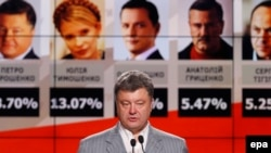 Ukraine's new president, Petro Poroshenko, speaks during a press conference in Kyiv on May 26.