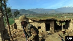 Pakistani soldiers patrol the compound of Taliban leaders in Bajaur, one of the country's tribal regions.