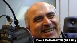 RFE/RL Georgian Service director David Kakabadze laughs during filming of the 'Inside Joke' feature.