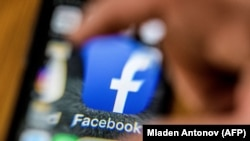 The icon for the social networking app Facebook on a smart phone screen - generic