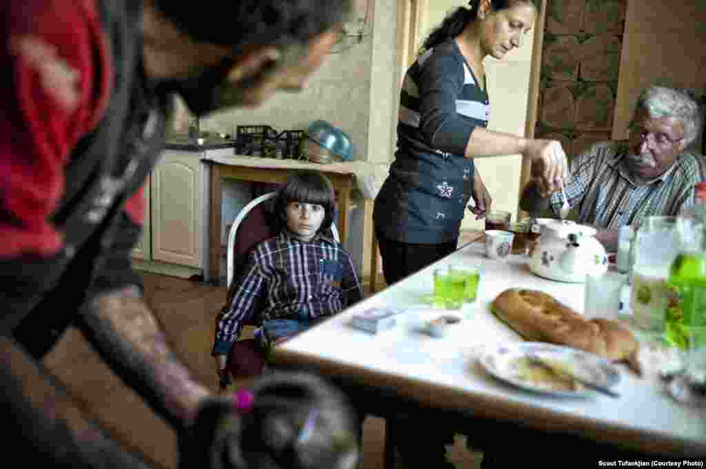 "A refugee family from Syria in the town of Berdzor in Nagorno-Karabkah. Many ethnic Armenians spoke to Tufankjian of feeling comfortable everywhere; others felt permanently isolated. ""I still feel like an outsider here,"" one Baku-born Armenian, now living in the United States, told her. ""And I'm an outsider in Armenia. So to me I don't know if I'll truly be comfortable somewhere."""