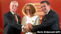 U.S. Defense Secretary Jim Mattis (left), Macedonian Prime Minister Zoran Zaev (right), and Macedonian Defense Minister Radmila Sekerinska shake hands after their meeting at the government building in Skopje on September 17.