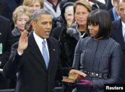 Президент США Барак Обама и его жена Мишель