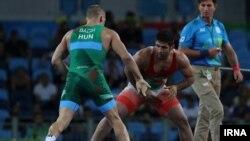 سعید عبدولی (با دوبنده قرمز) کاپیتان تیم ملی کشتی فرنگی ایران