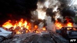 Пожар на месте взрыва бомбы в районе Бейрута Харет Хрейк, 2 января 2014 года.