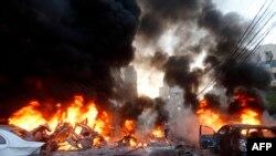 """На месте взрыва в Бейруте у штаб-квартиры """"Хезболлах"""", 2 января 2014 г."""