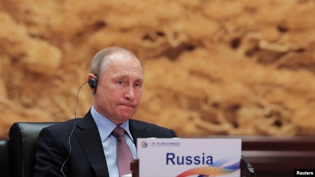 Russian President Vladimir Putin attends a roundtable session at the Belt And Road Forum in Beijing on May 15.