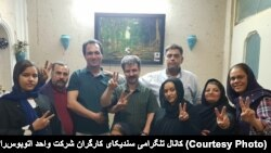 Reza Shahabi , labor activist , with his family after his release from prison on March 13.