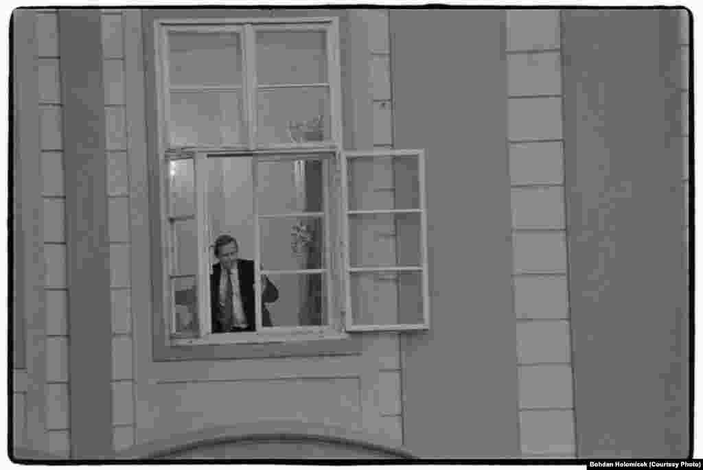 Havel appears in a window of Prague Castle in the early days of his presidency, on February 25, 1990.