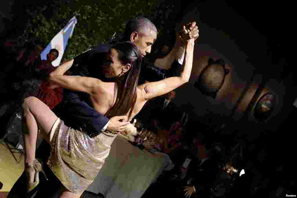 U.S. President Barack Obama dances the tango during a state dinner hosted by Argentina's President Mauricio Macri as part of Obama's two-day visit to Buenos Aires. (Reuters/Carlos Barria)