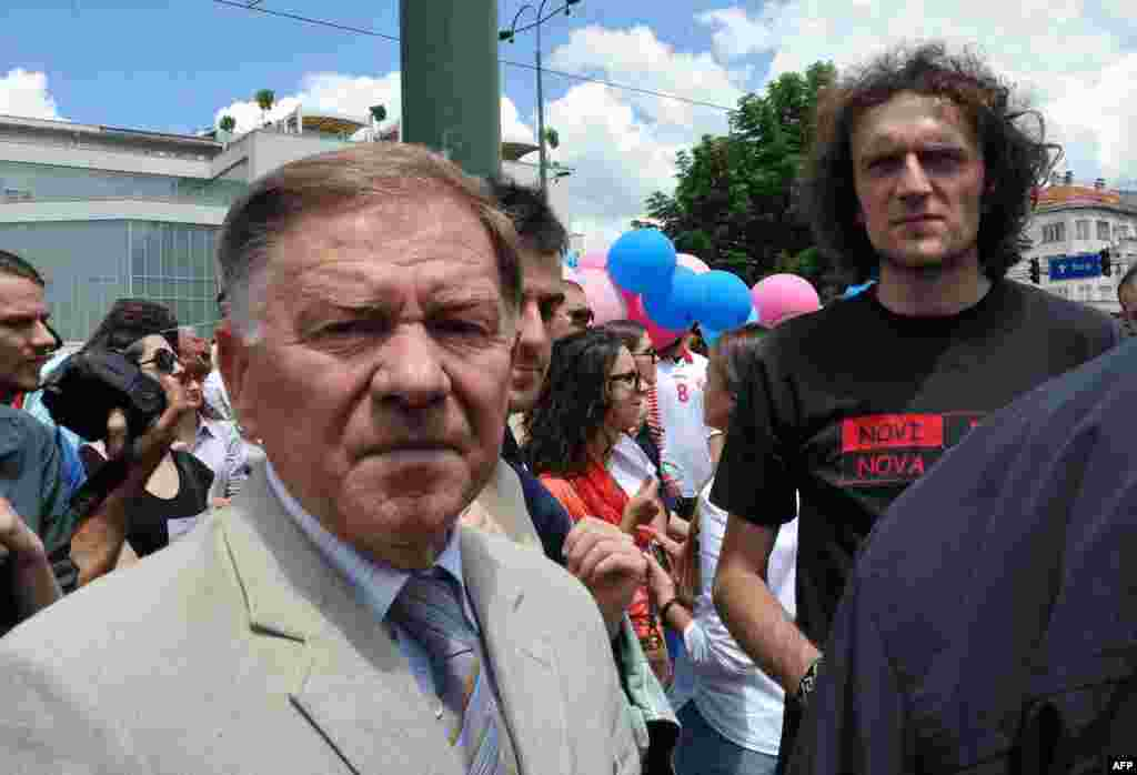 Sarajevo Mayor Ivo Komsic (left) stands with protesters gathering in front of the parliament building in Sarajevo.