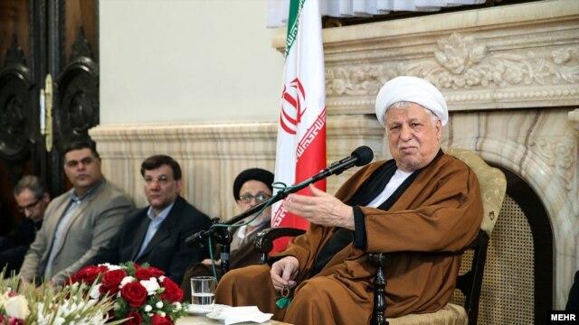 Former Iranian President Akbar Hashemi Rafsanjani (right)