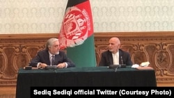 Afghan President Ashraf Ghani (R) and Abdullah Abdullah, his rival and former chief executive signed political agreement to end the election dispute on May 17.