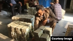 Piles of banknotes being smuggled are inspected by customs officials.