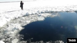 Russia's Emergency Situations Ministry released this photo of a hole in the ice atop a lake in the Chelyabinsk region thought to have been caused by a meteorite from the February 15 incident.