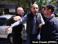 A driver argues with protesters who were blocking an intersection in Yerevan on April 26.