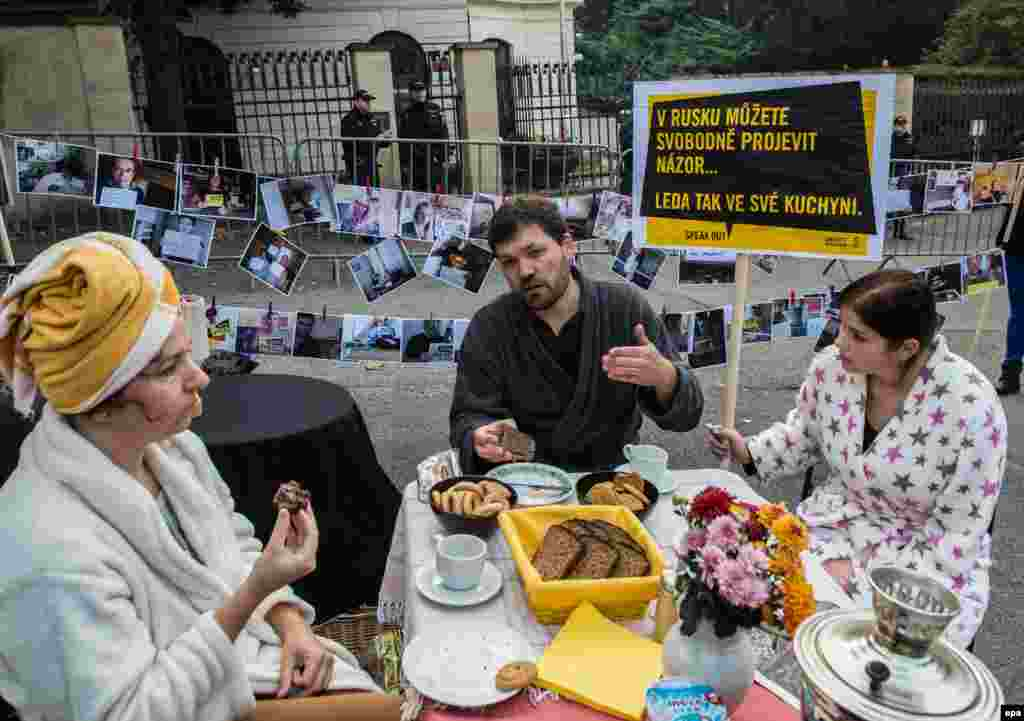 "Activists eat breakfast in a mock kitchen as they participate in a protest organized by Amnesty International in front of the Russian Embassy in Prague. The protest was part of Amnesty's campaign to show solidarity with independent voices in Russia speaking out against the country's government. The sign reads: ""In Russia, you can freely express your own opinion (only in your own kitchen).'"" (epa/Filip Singer)"