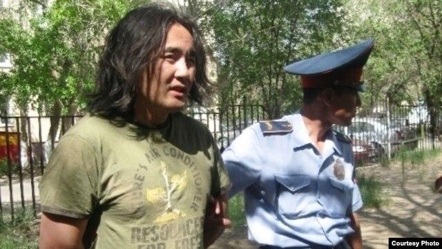 Kazakhstan opposition activist Aidos Sadyqov being arrested in July 2010.