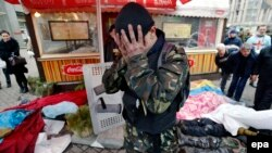 An activist mourns felllow protesters killed in clashes with riot police in Kyiv on February 20.