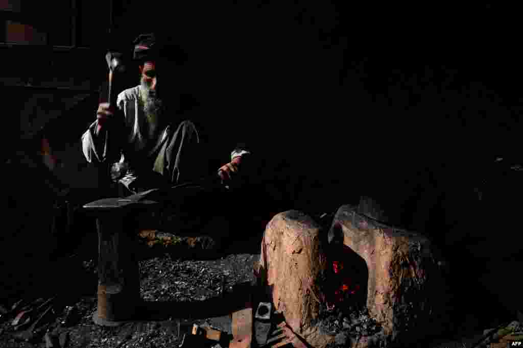 An Afghan man works in a ironsmith at a local factory in Herat. (AFP/Aref Karimi)