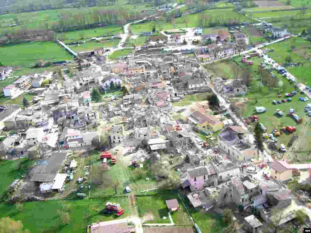 Italy -- The village of Onna seriously hit by the earthquake, in the province of L'Aquila, 06Apr2009 - Caption: epa01690056 A view from helicopter shows the village of Onna, in the province of L'Aquila, Italy seriously hit by the earthquake on 06 April 2009. Some 90 people died the quake, which struck the ancient town of L'Aquila and the surrounding mountainous areas about 100 km north-east of Rome in the early hours.