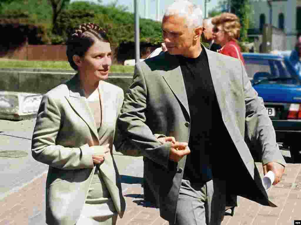 Yulia Tymoshenko walks with her husband, Oleksandr, in Kyiv in 2004.