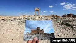 In front of the remains of the historic Temple of Bel ini Palmyra after it was destroyed by Islamic State, in a photo taken on March 31