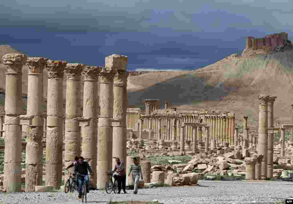 A year ago, all was quiet at Palmyra. This picture, from March 14, 2014, shows locals with bicycles at the ancient oasis city.