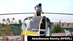 عباس بن فرناس البصري مشغول في بناء طائرته