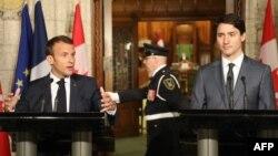 Франция президенті Эммануэль Макрон (сол жақта) мен Канада премьер-министрі Джастин Трюдо. Оттава, 7 маусым 2018 жыл.