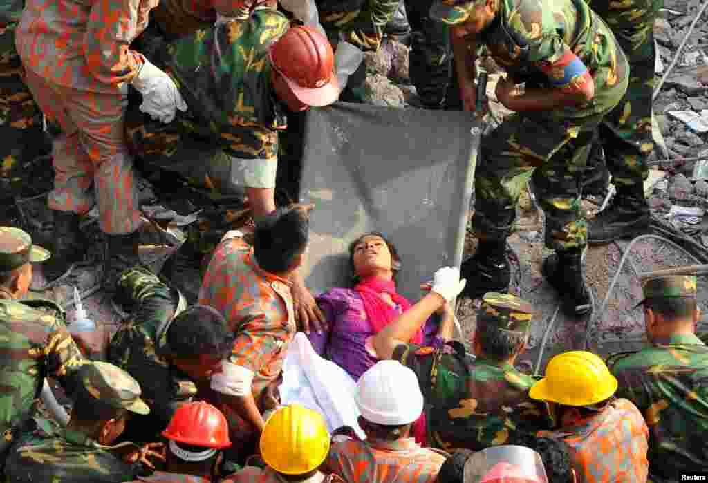 Rescue workers remove a woman alive from the rubble of the Rana Plaza building 17 days after the building collapsed in Savar, Bangladesh. More than 1,000 people were killed in the disaster. (Reuters/Sohel Ahmed)