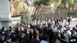 Iranian students scuffle with police at the University of Tehran during a demonstration in the capital Tehran on December 30, 2017.