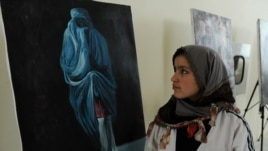 A visitor attends an exhibition in Herat to mark International Women's Day.