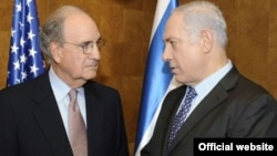 U.S. envoy to the Middle East George Mitchell (left) with Israeli Prime Minister Binyamin Netanyahu on September 29.
