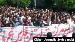A video grab from a video showing mass protests in southwestern city of Kazeroon, April 20, 2018