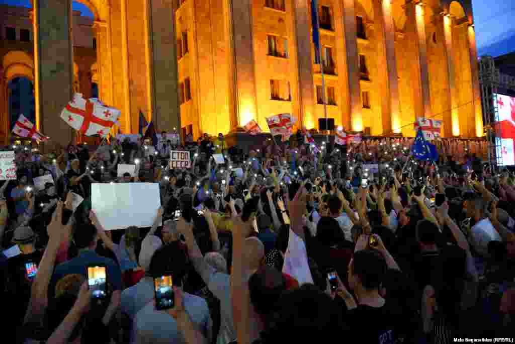 Protesters rally near the country's parliament in the capital, Tbilisi, on June 23.