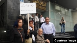 Nasrin Sotoudeh (holding sign) demonstrates in front of Iran's Bar Association in October.