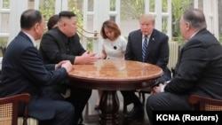 North Korean leader Kim Jong Un and U.S. President Donald Trump talk during the second North Korea-U.S. summit in Hanoi, February 28, 2019