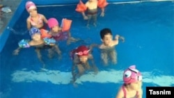 Photos like these, showing young girls and boys swimming together, resulted in a Tehran kindergarten being closed down.
