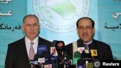 رئيس الوزراء نوري المالكي (يمين) ورئيس مجلس النواب أسامة النجيفي في مؤتمر صحفي ببغداد في 20 كانون الأول 2010.