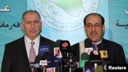 رئيسا السلطة التنفيذية والتشريعية في العراق، نوري المالكي وأسامة النجيفي في ؤتمر صحفي سابق.
