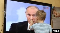 A Pochemuchka confronts Russian Prime Minister Vladimir Putin.
