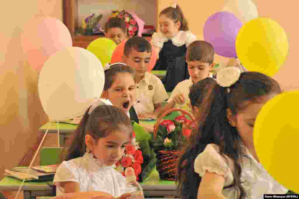Children gather for their first day of school after the summer holidays at the Nairi Zaryan school in Yerevan.
