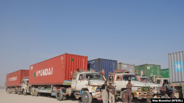 Pakistani drivers rest next to their NATO supply trucks on the Afghan-Pakistani border in Baluchistan Province on November 29.