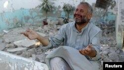 Сириянын аскерий күчтөрү Алеппого босоголош Азаз шаарчасына сокку уруп кайткандан кийинки көрүнүш. 15-август 2012