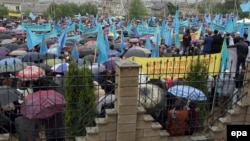 Crimean Tatars attend a commemoration ceremony in the Akmechet district of Simferopol on May 18.