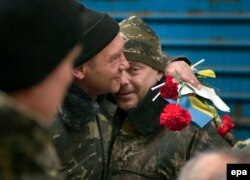 Relatives and friends in Lviv meet Ukrainian soldiers who have just returned from eastern Ukraine.