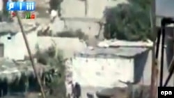 A video grab shows tanks and soldiers advancing in the city of Latakia.